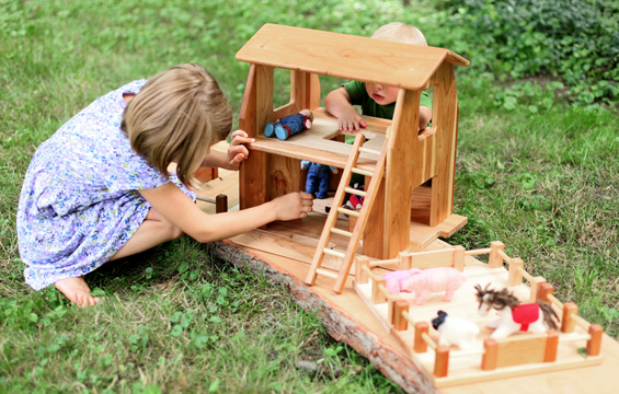 The natural wood farmhouse barn by Camden Rose for Palumba.com has a second story that functions as a dollhouse.